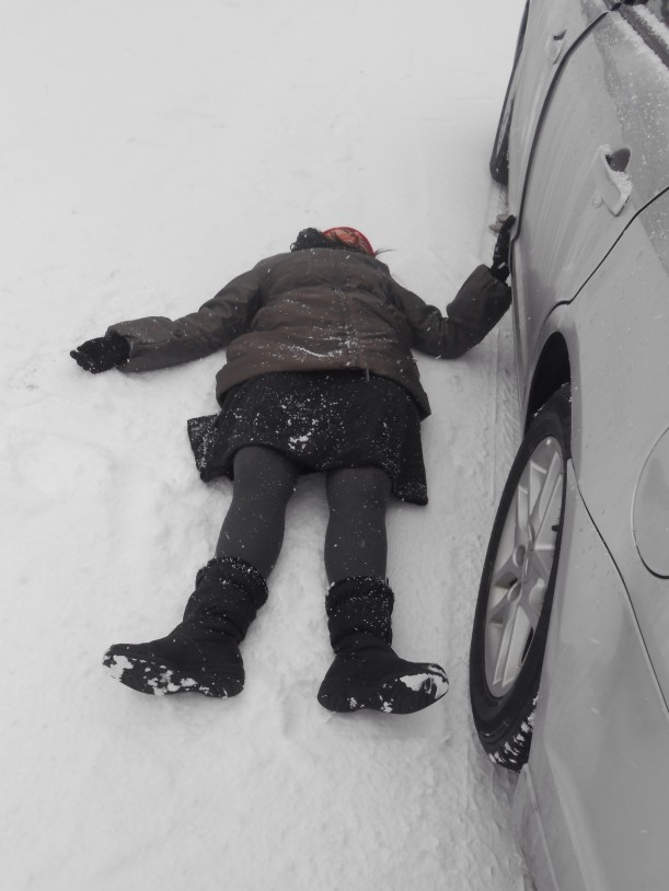 we were having a snowball fight. she goes and hides behind the car but she slips flat on her back. I didn't see it happen because I was getting my snowball. So I was like where you go? And she mutters out Whitney! And I go to the other side of the car and I see her like this! I about DIED!!!